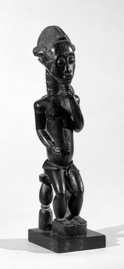 Baule. Male Figure Seated on a Stool, late 19th or early 20th century. Wood, glass beads, 19 x 4 3/4 x 4 1/2 in. (48.3 x 12.1 x 11.4 cm). Brooklyn Museum, By exchange, 69.39.4. Creative Commons-BY