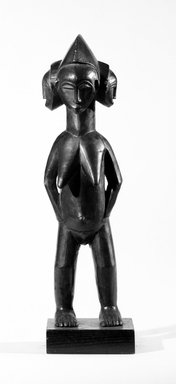 Guro. Standing Female Figure With Three Faces, late 19th-early 20th century. Wood, height: 17 5/16 in. (44.0 cm). Brooklyn Museum, Robert B. Woodward Memorial Fund and Gift of Arturo and Paul Peralta-Ramos, by exchange, 69.39.5. Creative Commons-BY