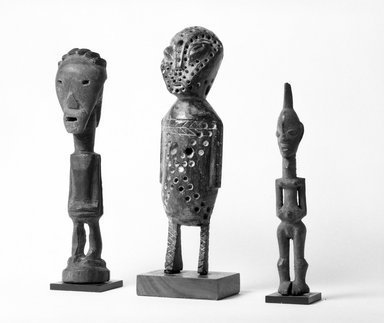 Lega. Standing Figure with Punctuations, late 19th or early 20th century. Wood, pigment, 9 1/4 x 2 1/2 x 2 1/2 in. (23.5 x 6.4 x 6.2 cm). Brooklyn Museum, Gift of David R. Markin, 70.107.17. Creative Commons-BY