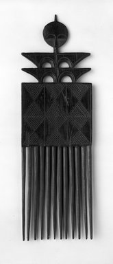 Akan. Comb, 20th century. Wood, 9 1/2 x 3 in. (24.1 x 7.6 cm). Brooklyn Museum, Gift of Ralph Nash to the Jennie Simpson Educational Collection of African Art, 70.30.2. Creative Commons-BY