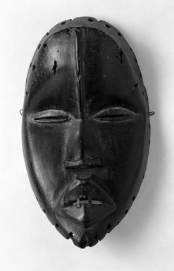 Dan. Mask, 19th or early 20th century. Wood, metal, pigment, 8 1/2 x 4 3/4 x 3 1/2 in. (21.6 x 12.1 x 8.9 cm). Brooklyn Museum, Gift of Merton D. Simpson to the Jennie Simpson Educational Collection of African Art, 70.73.3. Creative Commons-BY