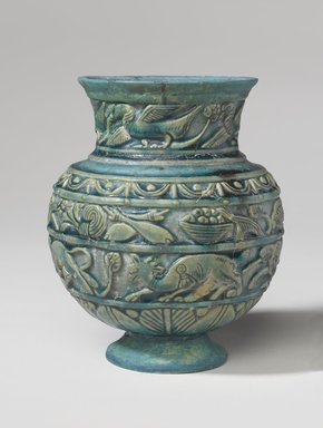 Vessel with Relief Decoration, ca. 1st century C.E. Faience, 7 1/4 x 5 1/2 x 5 1/2 in. (18.4 x 14 x 14 cm). Brooklyn Museum, Charles Edwin Wilbour Fund, 70.89.3. Creative Commons-BY