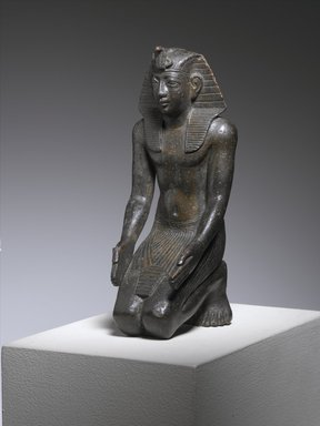 Statuette of King Necho, ca. 610-595 B.C.E. Bronze, 5 1/2 x 2 1/4 x 2 3/4in. (14 x 5.7 x 7cm). Brooklyn Museum, Charles Edwin Wilbour Fund, 71.11. Creative Commons-BY