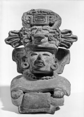 Zapotec. Effigy Urn. Terracotta, Height: 8 3/4 in. (22.3 cm). Brooklyn Museum, Gift of Ernest E. Erickson, 71.174.1. Creative Commons-BY