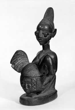 Yoruba. Kneeling Female Figure Holding Bowl with Face, late 19th or early 20th century. Wood, applied materials, 12 x bowl: 3 x lid:  5 1/2 in. (30.0 x 7.5 x 14.0 cm). Brooklyn Museum, Gift of Dr. and Mrs. Abbott A. Lippman, 71.177.4a-b. Creative Commons-BY