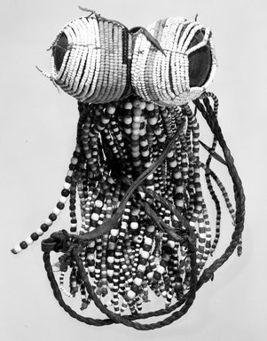 Turkana. Fertility Doll, late 19th - early 20th century. Beadwork over leather, wood, H: 5 1/4 in. (13.3 cm). Brooklyn Museum, Gift of Dr. Georges D. Rodrigues, 71.182. Creative Commons-BY