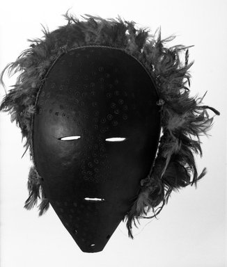 Lega. Mask with Feathers (Lukungu), late 19th or early 20th century. Gourd, feathers, fiber cord, 10 1/4 x 8 x 2 1/2 in. (26.0 x 20.3 x 6.3 cm). Brooklyn Museum, Gift of Jerome Furman, 71.19.6. Creative Commons-BY