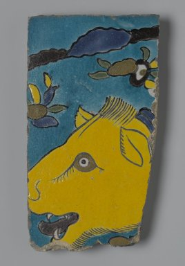 Tile Fragment Depicting a Lion in a Landscape, first half of the 17th century. Ceramic; fritware, painted in yellow, turquoise, cobalt blue, green, black, opaque white, purple, and ochre brown glazes with manganese purple in the cuerda seca (dry-cord) technique, 9 x 5 in. (22.9 x 12.7 cm). Brooklyn Museum, Gift of Mr. and Mrs. Charles K. Wilkinson, 71.194.2. Creative Commons-BY