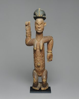 Kongo (Lumbo subgroup). Standing Female Figure, 19th century. Wood, pigment, 34 x 12 x 6 1/2 in. (86.4 x 30.5 x 16.5 cm). Brooklyn Museum, Gift of Marcia and John Friede, 71.202. Creative Commons-BY