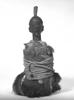 Tetela. Power Figure (Nkishi), early 20th century. Wood, fur, hide, fiber, horn, 17 in.  (43.2 cm). Brooklyn Museum, Gift of Fernandez Arman to the Jennie Simpson Educational Collection of African Art, 72.102.4. Creative Commons-BY