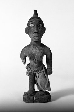 Kongo. Standing Female Figure, late 19th-early 20th century. Wood, pigment, fiber, glass mirror, 10 3/4 x 3 1/2 x 3 1/8 in. (27.0 x 9.0 x 8.0 cm). Brooklyn Museum, Gift of Fernandez Arman to the Jennie Simpson Educational Collection of African Art, 72.102.5. Creative Commons-BY