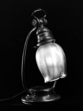 Tiffany Studios (1902-1932). Lamp, ca. 1900. Cast bronze, opalescent glass, Base: 11 13/16 x 6 1/4 x 5 1/8 in. (30 x 15.9 x 13 cm). Brooklyn Museum, Gift of Mrs. Frank Sanders, Jr., 72.15. Creative Commons-BY