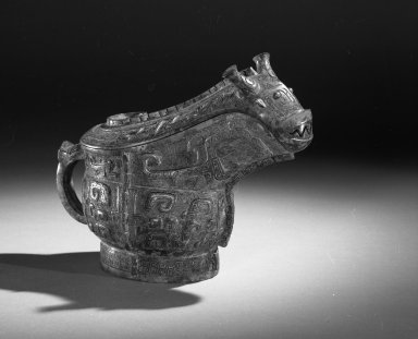 Ritual Wine Vessel (Guang), 13th-11th century B.C.E. Bronze, 6 1/2 x 3 1/4 x 8 1/2 in. (16.5 x 8.3 x 21.6 cm). Brooklyn Museum, Gift of Mr. and Mrs. Alastair B. Martin, the Guennol Collection, 72.163a-b. Creative Commons-BY