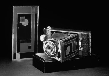 Ingraham Company. Camera, No. 1A Gift Kodak, ca.1930. Metal, leather, In upright, closed position (handle at top, bellows collapsed): 8 1/4 x 3 5/8 x 1 5/8 in. (21 x 9.2 x 4.1 cm). Brooklyn Museum, H. Randolph Lever Fund, 72.18a. Creative Commons-BY