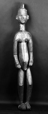 Igbo (northern). Standing Hermaphroditic Shrine Figure, late 19th or early 20th century. Wood, pigment, 65 1/4 x 12 x 10 in. (165.6 x 30.5 x 25.5cm). Brooklyn Museum, Gift of Vivian Merrin, 73.10.2. Creative Commons-BY