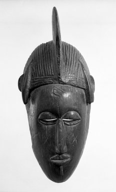 Senufo. Mask of a Human Face, late 19th or early 20th century. Wood, h: 12 3/4 in. (32.5 cm). Brooklyn Museum, Gift of Mr. and Mrs. John A. Friede, 73.107.9. Creative Commons-BY