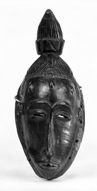 Guro. Mask with Conical Topknot, late 19th-early 20th century. Wood, pigment, 11 1/2 x 5 in. (29.3 x 12.7 cm). Brooklyn Museum, Gift of Dr. and Mrs. Abbott A. Lippman, 73.154.10. Creative Commons-BY