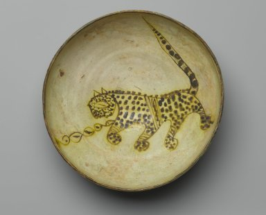 Bowl Depicting a Cheetah, 10th century. Ceramic; earthenware, painted in yellow-staining black slip on a white slip ground under a transparent glaze, 3 3/8 x 8 7/8 in. (8.5 x 22.5 cm). Brooklyn Museum, Frederick Loeser Fund, 73.165. Creative Commons-BY