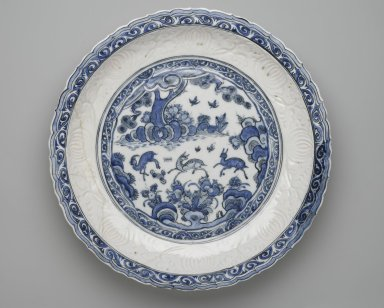 Platter (Tabaq) with Chinese Landscape, first half 17th century. Ceramic; fritware, molded and painted in cobalt blue under a transparent glaze, Gr. diam.: 19 in. (48.3 cm). Brooklyn Museum, Carll H. de Silver Fund, 73.166. Creative Commons-BY