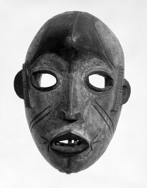 Idoma. Mask of Face with Void Eyes, early 20th century. Wood, wire, teeth, pigment, 8 1/4 x 6 x 4 1/2 in. (21.0 x 15.1 x 11.5 cm). Brooklyn Museum, Gift of Ruth R. Gross, 73.180.3. Creative Commons-BY