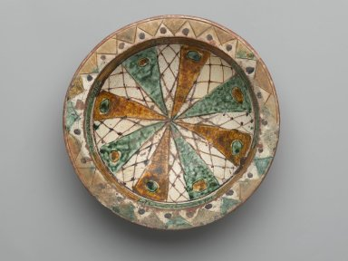 Bowl with Incised Decoration, 12th - 13th century. Ceramic, sgraffiato (incised) ware; earthenware, incised and painted with manganese purple, ochre, and green under a transparent glaze, Foot: 5/8 x 3 in. (1.6 x 7.6 cm). Brooklyn Museum, Gift of The Roebling Society, 73.30.1. Creative Commons-BY