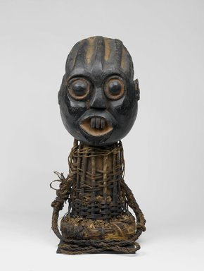 Bamum. Funerary Headdress (Tugunga), late 19th century. Wood, rattan, pigment, 33 x 14 3/16 x 14 3/16 in. (83.8 x 36 x 36 cm). Brooklyn Museum, Gift of Mrs. Melville W. Hall, 73.36. Creative Commons-BY