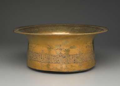 Basin Inscribed with Honorifics in Arabic Thuluth Script, mid 14th century. Brass, incised, punched, and inlaid with silver, 7 1/16 x 16 15/16 in. (18 x 43 cm). Brooklyn Museum, Gift of Mr. and Mrs. Charles K. Wilkinson, 73.94.4. Creative Commons-BY