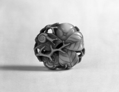 Netsuke Depicting Two Persimmons and a Snail, 19th century. Ivory, 1/2 x 1 1/2 in. (1.3 x 3.8 cm). Brooklyn Museum, Gift of Mr. and Mrs. Burton Krouner, 74.103.9. Creative Commons-BY