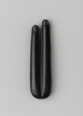 Ptolemaic. Amulet Representing Two Fingers, 332-30 B.C. Obsidian, 3/8 x 7/8 x 3 1/4 in. (1 x 2.2 x 8.3 cm). Brooklyn Museum, Charles Edwin Wilbour Fund, 74.158. Creative Commons-BY