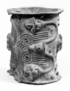 Yoruba. Brass Altar Stand, late 19th or early 20th century. Copper alloy, pigment, 4 7/8 x 4 1/4 in. (12.5 x 11 cm). Brooklyn Museum, Gift of Mr. and Mrs. Aaron Furman, 74.172.1. Creative Commons-BY