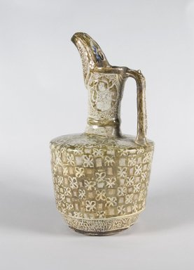 Ewer, early 13th century. Ceramic; fritware, painted in golden brown luster and blue glaze over an opaque white glaze, 14 3/8 x 7 3/4 in. (36.5 x 19.7 cm). Brooklyn Museum, Gift of Mr. and Mrs. Paul E. Manheim, 74.196. Creative Commons-BY
