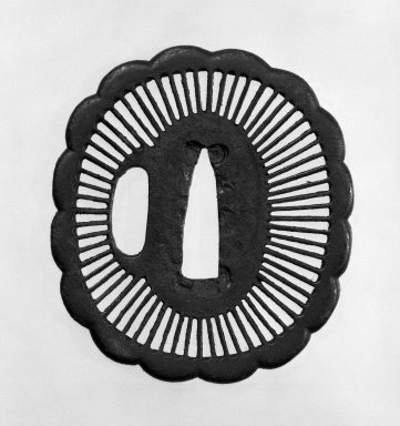 Tsuba (Sword Guard), 17th century. Brown-black patinated iron, 2 3/4 x 2 3/8 in. (7 x 6 cm). Brooklyn Museum, Gift of Leighton R. Longhi, 74.202.17. Creative Commons-BY