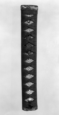 Tsuka (Sword Handle), 18th century. Wood, ray skin, dark blue silk cord, handle: 1 9/16 x 9 1/16 in. (4 x 23 cm). Brooklyn Museum, Gift of Leighton R. Longhi, 74.202.4. Creative Commons-BY