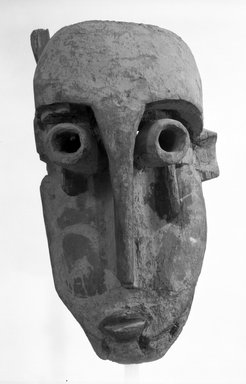 Fang. Mask with Asymmetrical Face (Ekekek), late 19th-early 20th century. Wood, 22 1/2 x 9 1/2 x 11 1/2 in. (57.2 x 24.1 x 29.4 cm). Brooklyn Museum, Gift of Mr. and Mrs. Gordon Douglas, 74.211.1. Creative Commons-BY