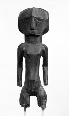 Buyu. Standing Male Figure, late 19th or early 20th century. Wood, 22 1/2 x 6 3/4 x 8in. (57.2 x 17.1 x 20.3cm). Brooklyn Museum, Gift of Mr. and Mrs. Gordon Douglas, 74.211.8. Creative Commons-BY