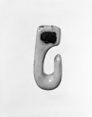 Eskimo (Native American). Hook-shaped Toggle, late 19th-early 20th century. Ivory, wood, leather, 2 7/8 in. or (7.4 cm). Brooklyn Museum, Gift of Mr. and Mrs. John A. Friede, 74.212.4. Creative Commons-BY