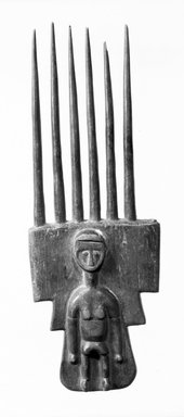 Attie. Comb, late 19th-early 20th century. Wood, 7 7/8 x 2 11/16 in. (20 x 6.8 cm). Brooklyn Museum, Gift of Dr. and Mrs. Willi Riese to the Jennie Simpson Educational Collection of African Art, 74.217.2. Creative Commons-BY