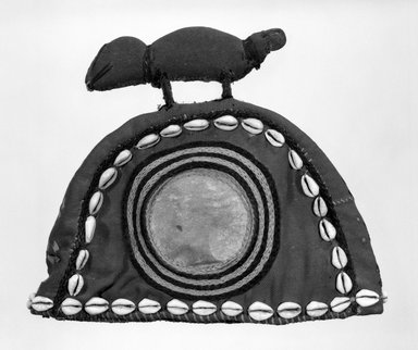 Baule. Hat, mid-20th century. Red twill over leather, cowrie shells, yarn, 8 3/4 x 10 1/8 in. (22.2 x 25.7 cm). Brooklyn Museum, Gift of Dr. and Mrs. Willi Riese to the Jennie Simpson Educational Collection of African Art, 74.217.4. Creative Commons-BY