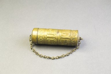 Asante. Cylindrical Container. Copper alloy, Diam.: 1 x  L. without chain: 3 3/8 in. (2.5 x 8.6 cm). Brooklyn Museum, The Franklin H. Williams Collection of Ashanti Brass Weights and Accessory Objects for Weighing Gold, Gift of Mrs. and Mrs. Franklin H. Williams, 74.218.120. Creative Commons-BY