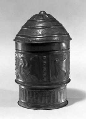 Asante. Cylindrical Container with Lid  (Forowa), late 19th-early 20th century. Beaten sheet brass, 6 7/8 x 4 1/16 x 4 1/16 (17.5 x 10.3 x 10.3 cm). Brooklyn Museum, The Franklin H. Williams Collection of Ashanti Brass Weights and Accessory Objects for Weighing Gold, Gift of Mrs. and Mrs. Franklin H. Williams, 74.218.121a-b. Creative Commons-BY