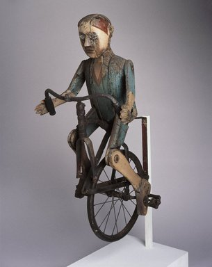 Lewis Simon (American, 1884-1970). Trade Sign (Boy Riding Bicycle), 1932-1934. Painted wood, metal, rubber, other materials, 40 1/2 x 18 x 23 in.  (102.9 x 45.7 x 58.4 cm). Brooklyn Museum, H. Randolph Lever Fund and Dick S. Ramsay Fund, 74.29. Creative Commons-BY