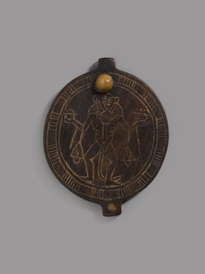 Lid of Circular Cosmetic Container with Birth God, ca. 1479-1400 B.C.E. Wood, paste?, 3 1/8 x 2 1/2 x 3/16 in. (7.9 x 6.3 x 0.5 cm). Brooklyn Museum, Charles Edwin Wilbour Fund, 74.45. Creative Commons-BY