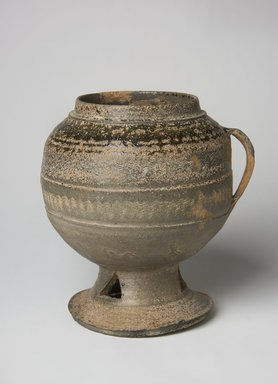 Pedestal Jar, 5th century. Stoneware with ash glaze, Height: 7 1/16 in. (18 cm). Brooklyn Museum, Gift of Nathan Hammer, 74.61.8. Creative Commons-BY