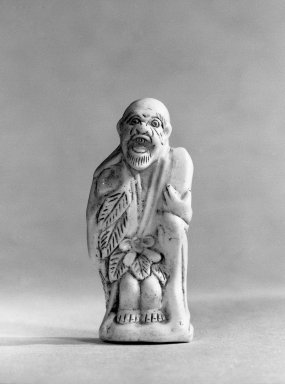 Sennin (Taoist Immortal). Porcelain, 7/8 x 2 1/8 x 13/16 in. (2.3 x 5.4 x 2.1 cm). Brooklyn Museum, Designated Purchase Fund, 74.80.2. Creative Commons-BY