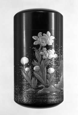 Inro, Gold Peonies and Rocks, 18th-19th century. Wood, lacquer, 3 9/16 x 1 7/8 in. (9 x 4.7 cm). Brooklyn Museum, Gift of Mr. and Mrs. Tessim Zorach, 75.10.1. Creative Commons-BY