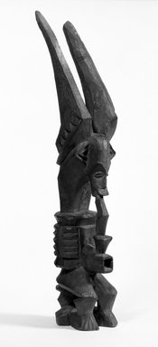 Igbo (northern). Figure (Ikenga), early 20th century. Wood, 16 x 3 x 4 in. (40.3 x 7.8 x 10.2 cm). Brooklyn Museum, Gift of Dr. Ernst Anspach, 75.147.2. Creative Commons-BY