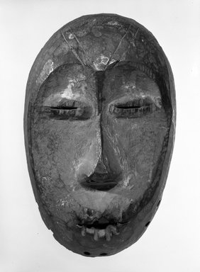 Lega. Maskette (Lukwakongo), late 19th or early 20th century. Wood, 7 7/8 x 4 7/8 x 2 1/8 in. (20.0 x 12.4 x 5 .5 cm). Brooklyn Museum, Gift of Dr. Ernst Anspach, 75.147.3. Creative Commons-BY