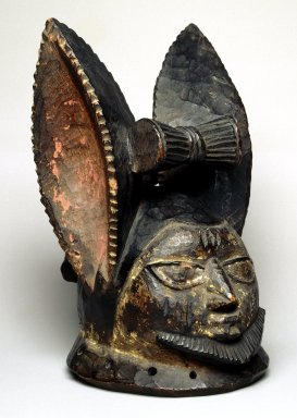 Yoruba. Ancestor Headdress (Ere Egungun), late 19th or early 20th century. Wood, pigment, ferrous nails, H: 11 1/2 in. (29.2 cm). Brooklyn Museum, Gift of Dr. and Mrs. Abbott A. Lippman, 75.149.1. Creative Commons-BY
