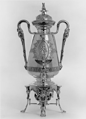 J. E. Caldwell & Co.. Urn with Cover, Figure on Spigot, Stand and Fuel Lamp, ca. 1875. Sterling silver, ivory, Overall height of unit: 20 13/16 in. (52.9 cm). Brooklyn Museum, H. Randolph Lever Fund, 75.164.1a-e. Creative Commons-BY