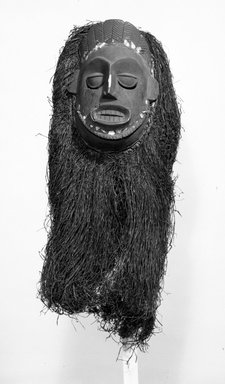 Ibibio. Ekpo Society Mask with Fringe Attachment, early 20th century. Wood, raffia or palm fiber, organic material, cloth fiber, 29 x 15 x 8 in. (73.7 x 38.1 x 20.4 cm). Brooklyn Museum, Gift of Mr. and Mrs. J. Gordon Douglas III, 75.189.7. Creative Commons-BY